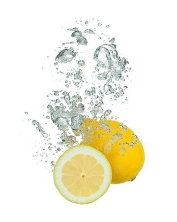 Isolated shot of lemon falling into water, isolated on white background