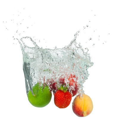 falling water: Isolated shot of fruit falling into water, isolated on white background Stock Photo