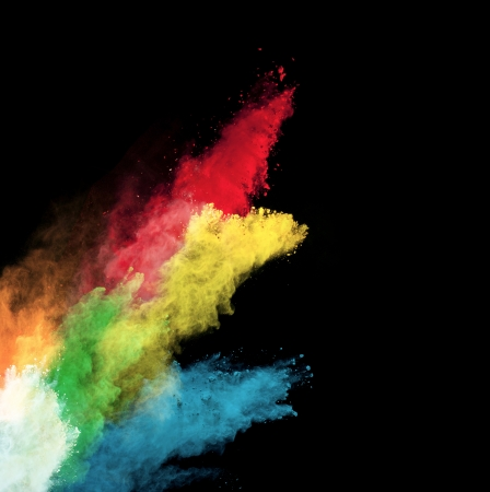 explode: Freeze motion of colored dust explosion isolated on black background Stock Photo