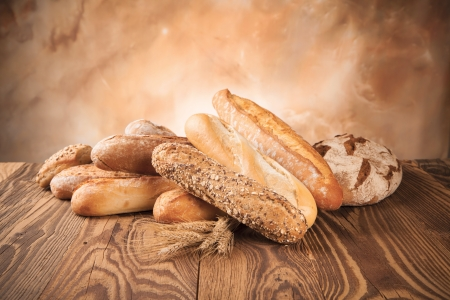 french bread: various kinds of bread on wood Stock Photo