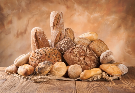 loaf of bread: various kinds of bread on wood Stock Photo