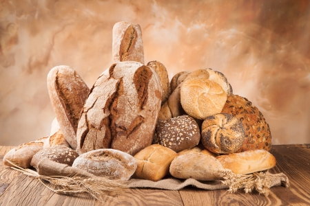 bakers: various kinds of bread on wood Stock Photo