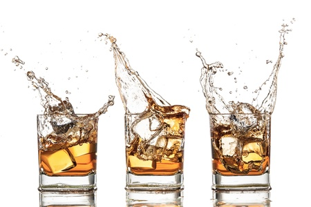 Isolated shots of whiskey with splash on white background photo