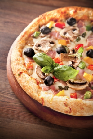 Delicious fresh pizza served on wooden table photo
