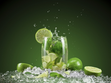 Mojito cocktail with splash and ice Фото со стока