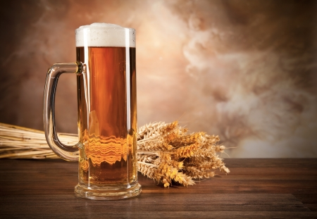 woden: Glass of beer on woden table Stock Photo