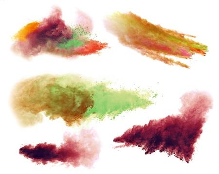 пыль: Заморозить движение цветного взрыва пыли, изолированных на белом фоне Фото со стока