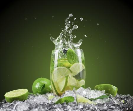 soda splash: Mojito cocktail with splash and ice Stock Photo