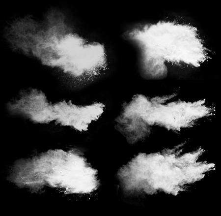 Freeze motion of white dust explosion isolated on black background