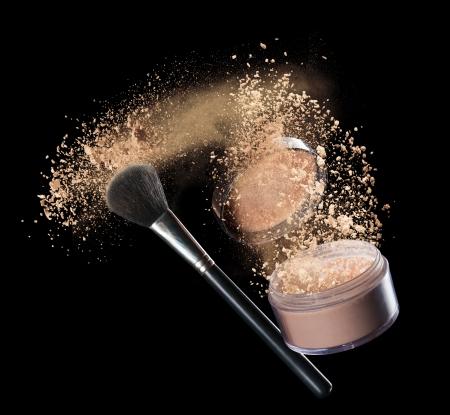 bronze bowl: Isolated make-up powder with brush on black background Stock Photo