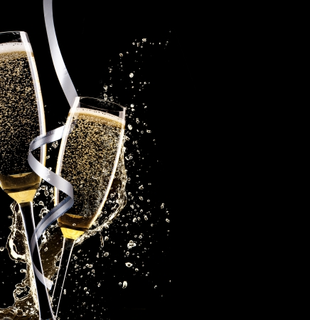 Glasses of champagne with splash, isolated on black background Stock Photo - 22535102