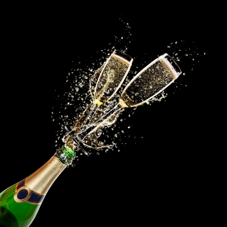 Glasses of champagne with bottle, isolated on black background