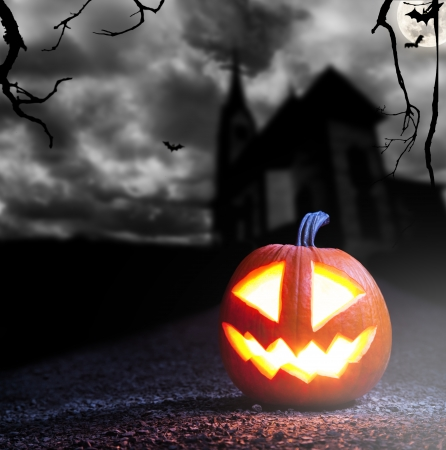 Concept of halloween with burning pumpkin Stock Photo