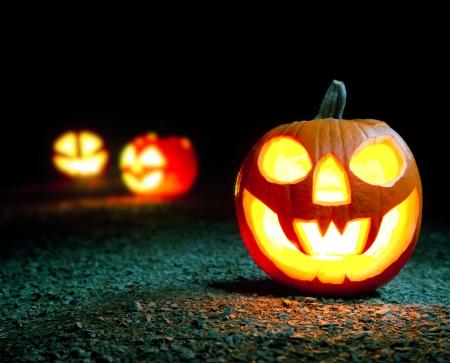 Burning halloween pumpkin in forest