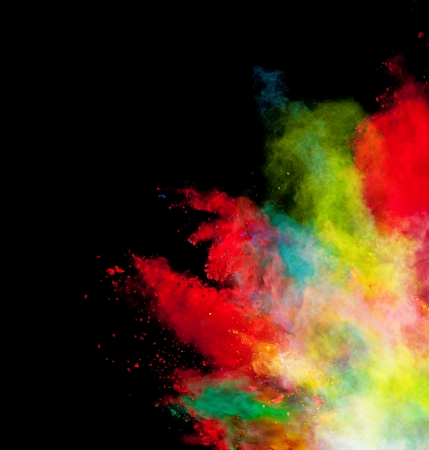 paint splash: Freeze motion of colored dust explosion isolated on black background Stock Photo