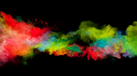 splash paint: Freeze motion of colored dust explosion isolated on black background Stock Photo