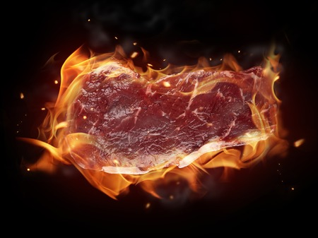 Raw steak on fire