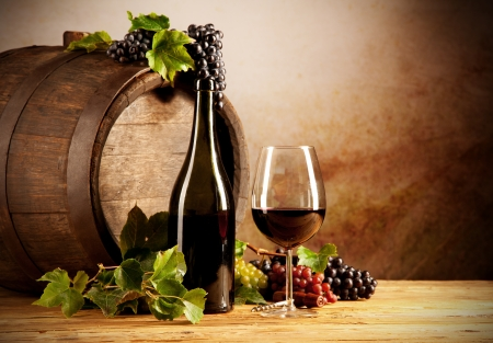 Still life of wine with wooden keg photo