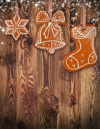 vertical: Traditional gingerbread hanging on wooden background Stock Photo