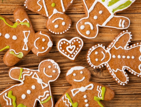 Christmas concept with traditional gingerbread cookies on wood photo