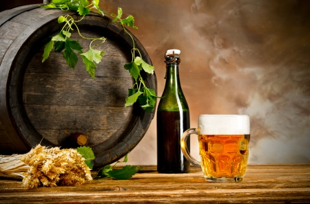 beer barrel: Beer keg with glass of beer  Stock Photo