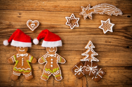 Christmas still life with traditional gingerbread cookies on wood photo