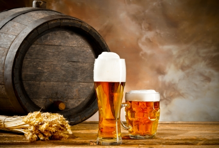 beer barrel: Beer keg with glasses of beer and blur background Stock Photo