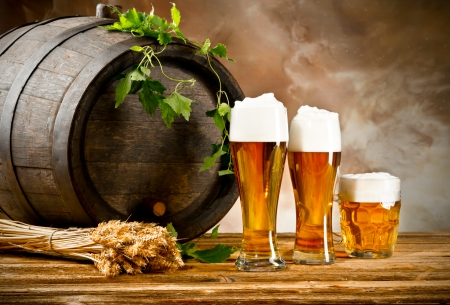 wooden barrel: Beer keg with glasses of beer and blur  Stock Photo