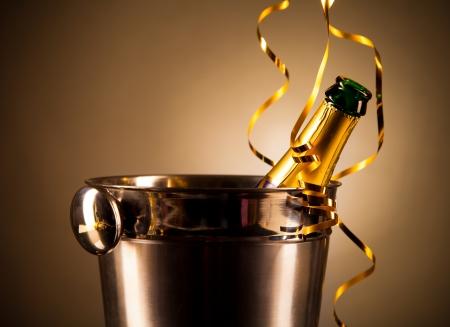 Bottle of champagne in silver bucket photo