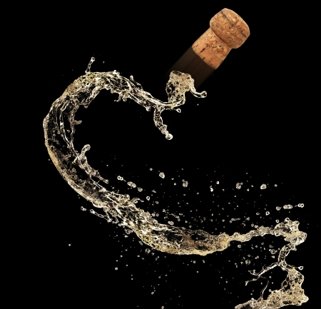 champagne cork: Cork of champagne in splash, isolated on black background