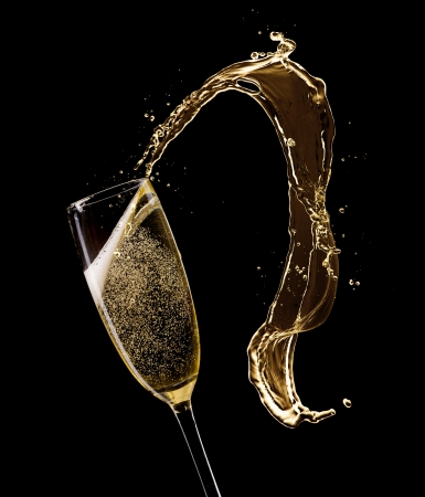 champagne glass: Glass of champagne with splash, isolated on black Stock Photo