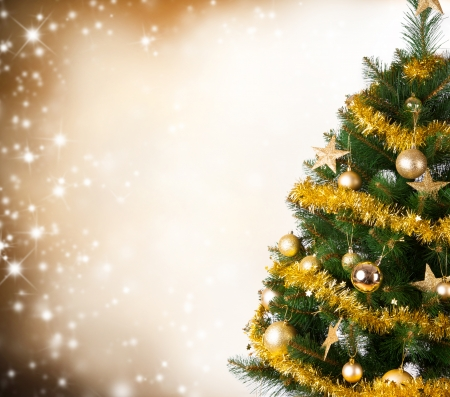 Christmas tree with golden decoration photo