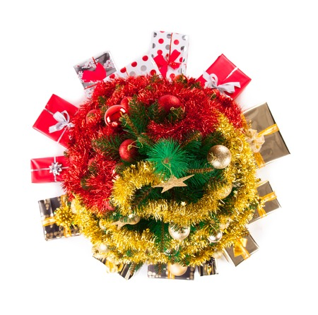 top of the year: Isolated shot of christmas tree with gifts on white background, uper view Stock Photo