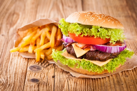 burger and fries: Delicious hamburger on wood
