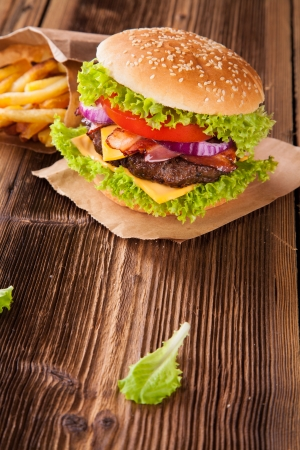 Delicious hamburger on wood photo