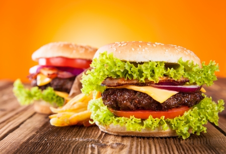 burger and fries: Delicious hamburgers on wood