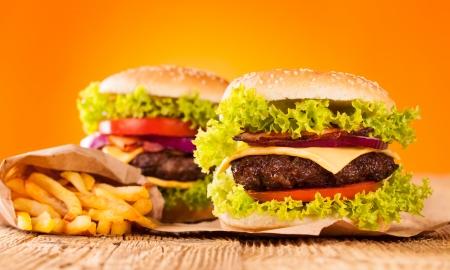 Delicious hamburgers on wood