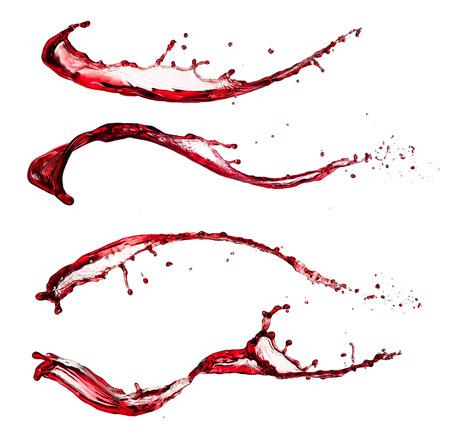 Geïsoleerde shot van rode wijn spatten op wit