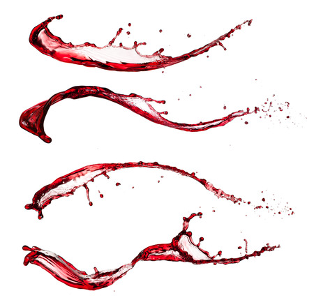 Isolated shot of red wine splashes on white Stock Photo