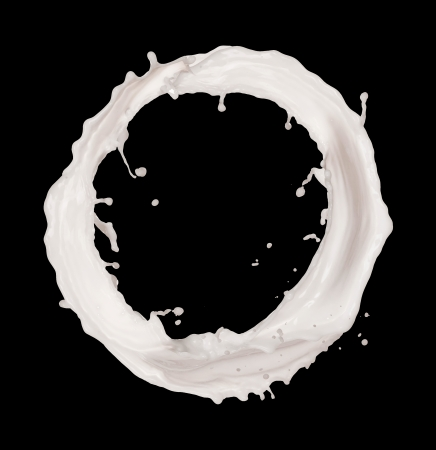 milk splash: Isolated shots of milk splashes in circle shape on black