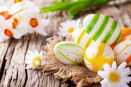 Easter still life with traditional decorative colored eggs in nest
