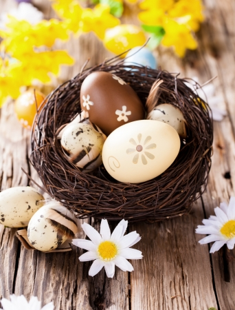 Easter still life with traditional decorative eggs in nest photo