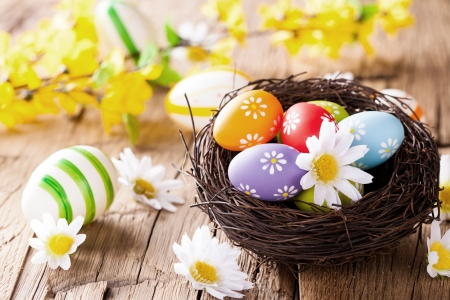 easter nest: Easter still life with traditional decorative colored eggs in nest Stock Photo