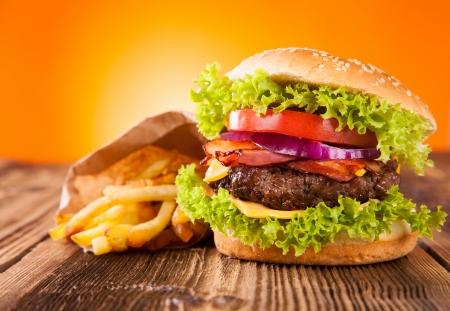 Delicious hamburger on wood photo