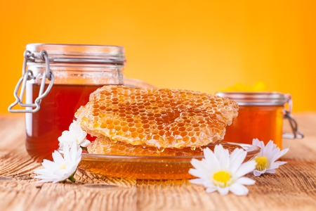 Still life of honey on wooden table photo