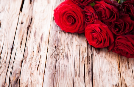 Detail of red roses on wood, low depth of focus photo