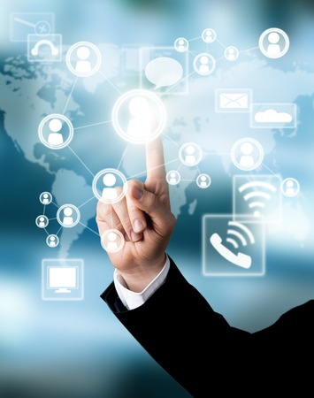Businessman hand touching virtual scheme with icons Imagens