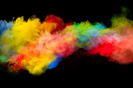 splatter: Freeze motion of colored dust explosion isolated on black background Stock Photo