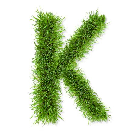 letter writing: Fresh grass letter  K  isolated on white background