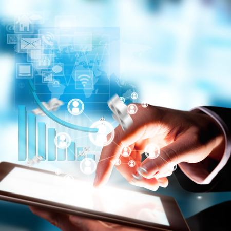 Business concept with man hand touching tablet computer  Virtual icons around photo